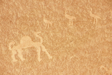 Prehistoric rock painting in the sand desert Wadi Rum, Jordan.
