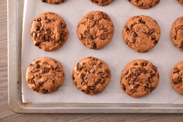 Foto op Aluminium Koekjes Homemade cookies with chocolate chips baked top detail
