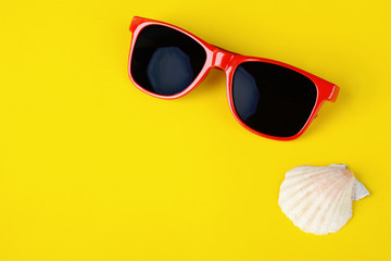 Fashionable sunglasses and shells with copyspace