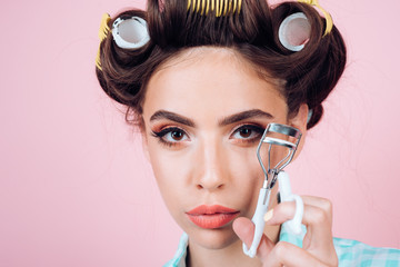 beauty salon hairdresser. retro woman with fashion makeup and hair. vintage housewife woman curl eyelash with tool. Pinup girl. happy girl grooming in morning. Loving her new style. Feeling flirty