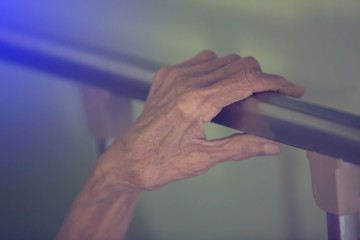 Hand of old woman sleep in bed. Wall mural