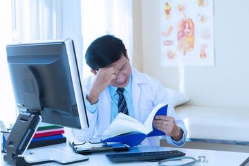 doctor man worried on desk in hospital