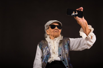 Old woman taking selfies