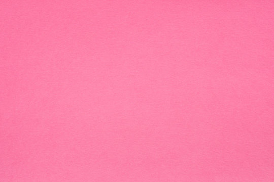 pink paper texture background. colored cardboard fibers and grain. empty space concept.
