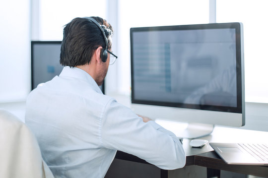 close up.businessman looking at the monitor of a modern computer