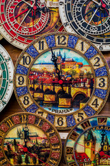 Vibrant multi colored wooden clock. Paint about Prague inside of Clock. One,Two,Three,Four,Five,Six,Seven,Eight,Nine,Ten.