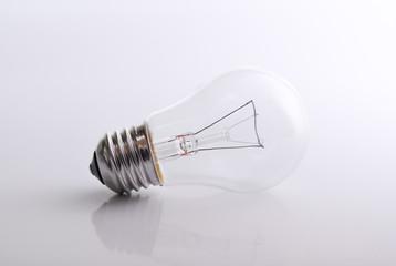 Light bulb on white / grey