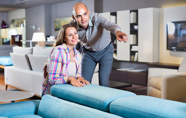 Married couple looking for new stylish sofa