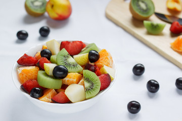Fresh salad with various fruits. Healthy lifestyle.