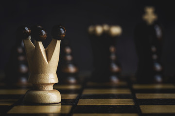 Game and chess pieces on dark background