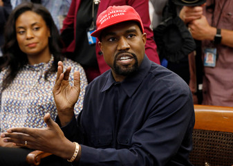 Rapper Kanye West speaks during a meeting with President Trump and others in the Oval Office at the White House in Washington