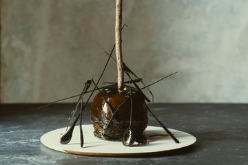 Caramel halloween apple, decorated with crystallized caramel
