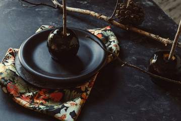 Black caramel apples, Autumn snack of homemade. Halloween