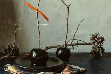 Black caramel apples, Autumn snack of homemade