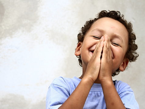 little boy praying to god stock photo