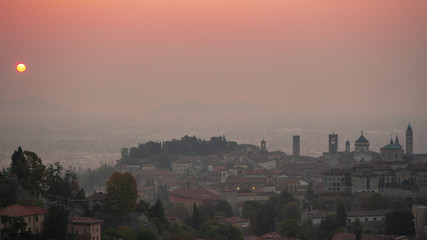 Bergamo. One of the beautiful city in Italy. Morning landscape at the old town from Saint Vigilio hill during fall season