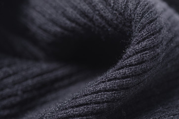 Black sweater fabric textile material texture macro blur background