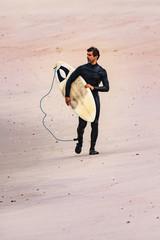 Male surfer wearing wetsuit