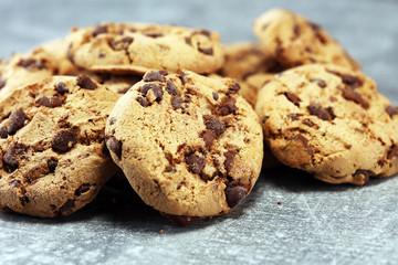 Chocolate cookies on rustic table. Chocolate chip cookies shot