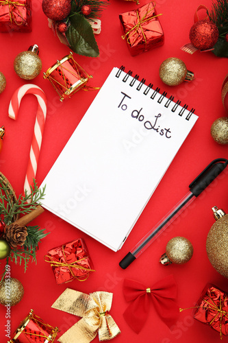 to do list in notepad with christmas decorations on red background - Christmas Decorations List