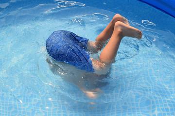 Teenager having fun jumping in swimming pool
