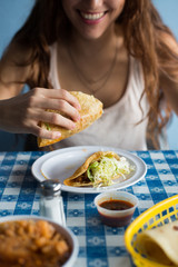 Eating mexican fried tacos.