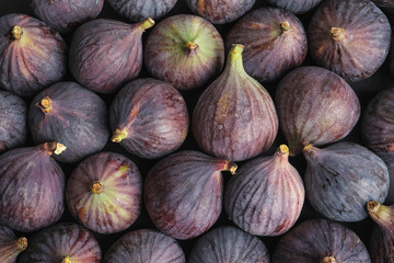 Many whole fresh purple figs as background, top view