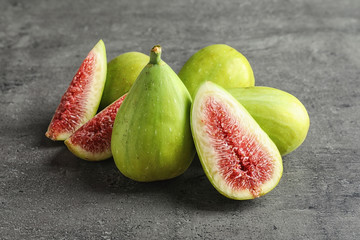 Fresh ripe figs on gray background. Tropical fruit