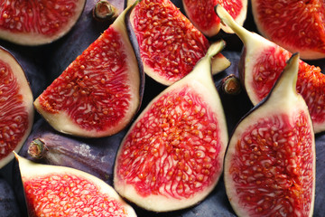 Fresh ripe fig slices as background, top view. Tropical fruit