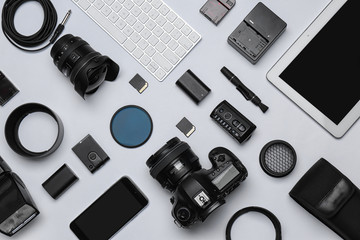 Flat lay composition with equipment for professional photographer on white background Fotobehang
