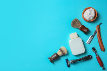 Flat lay composition with shaving accessories for men on color background. Space for text