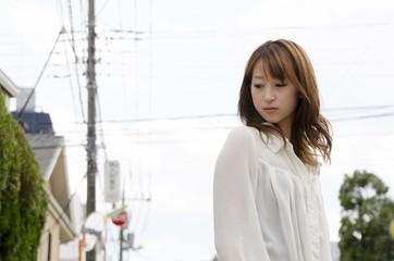 Japanese Girl poses on the street in Jiyugaoka, Japan. Jiyugaoka is a town located in Tokyo.