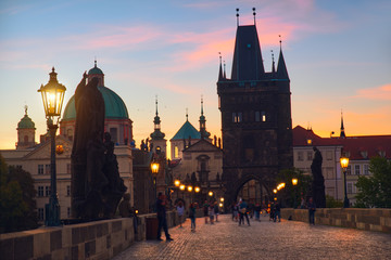 Fotomurales - Charles Bridge at dawn: silhouettes of Old Bridge Tower and spires of Old Prague on a sunrise