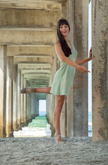 Ballerina in a Green Dress Dancing Under the Pier