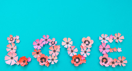 Flower and leaves of paper turquoise background