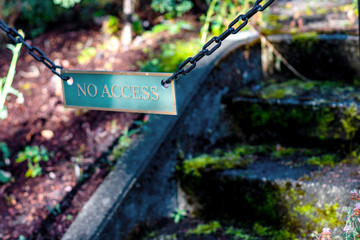 No access sign on moss covered concrete stairs