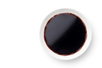 Dish of soy sauce isolated on white background. Top view.