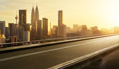 Fotomurales - Empty asphalt flyover  road with modern cityscape skyline , sunrise scene .