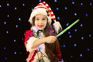 girl in a leprechaun costume with a magic wand in his hands