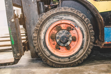 The front wheels of the forklift.