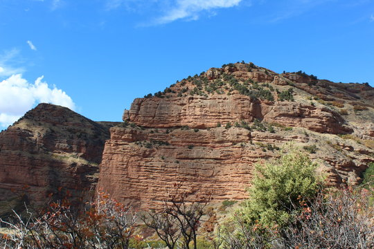 Utah has many beautiful rock cliff faces along Weber river and Echo Canyon. the rocks are red toned and the sky is blue