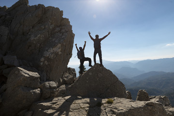 peak success, people achieving together and insatiable landscape