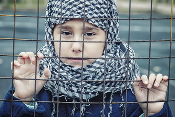 a refugee girl from the east in a headscarf