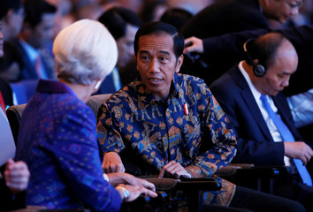 IMF Managing Director Christine Lagarde (L) talks to Indonesia President Joko Widodo during plenary session at International Monetary Fund - World Bank Annual Meeting 2018 in Nusa Dua