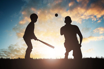 Boy Playing Baseball With His Father