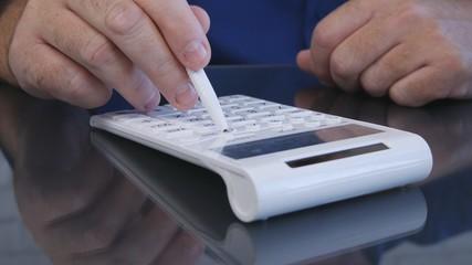 Businessman Calculates Using a Pen and Adding Machine