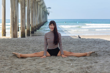 Ballerina Doing the Splits at the Beach on the Sand