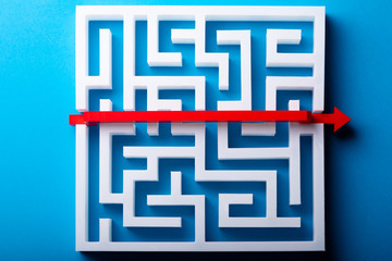 Red Arrow Crossing Over White Maze
