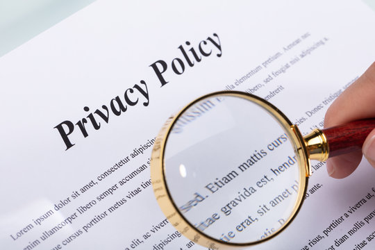 Woman Holding Pen Over Privacy Policy Form
