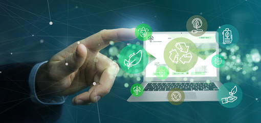 Businessman holding a Cloud of green ecology icon bubble with a laptop 3d rendering